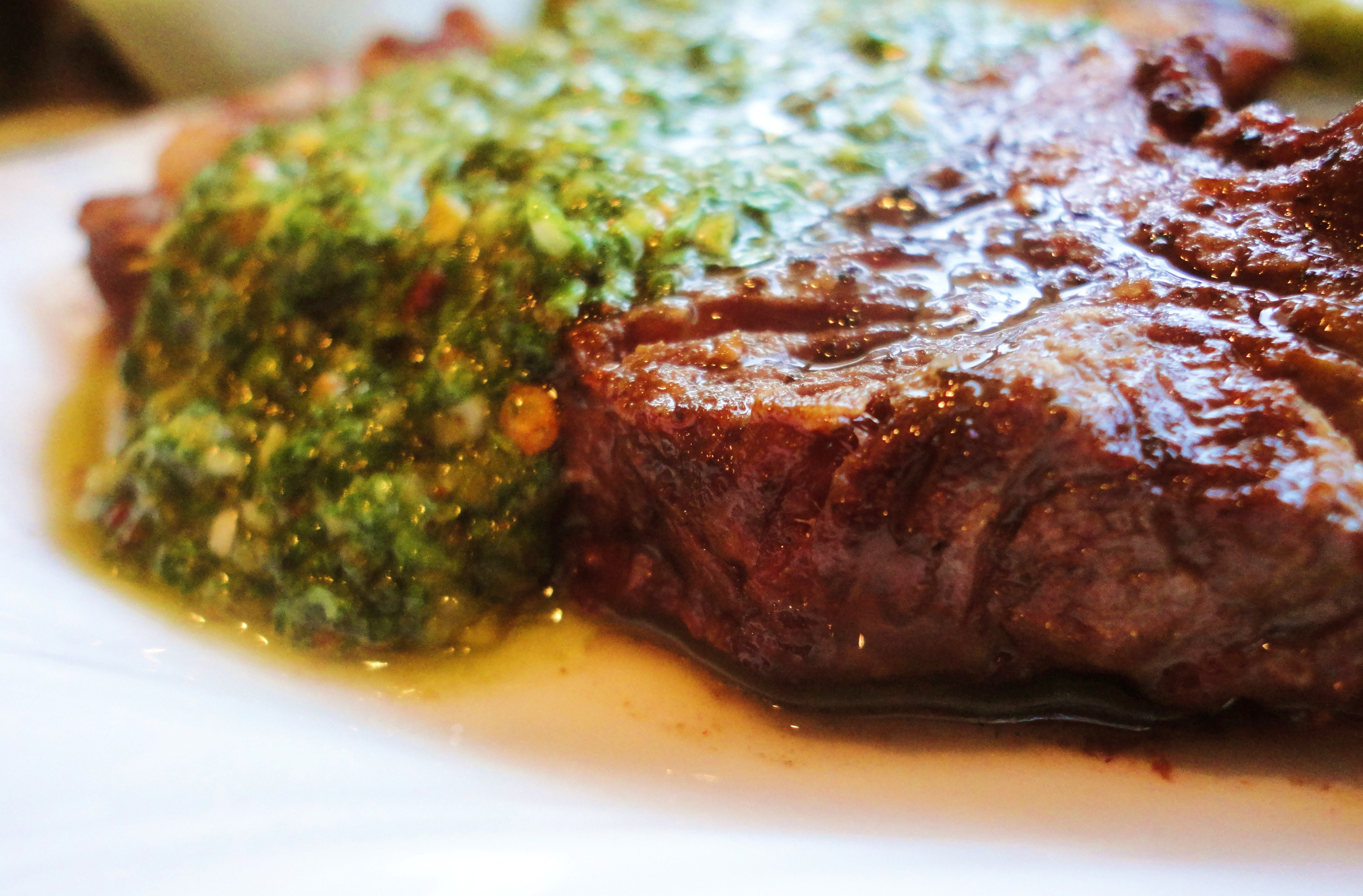 ... grilled tender hanger steak smothered in vibrant tangy cilantro mint